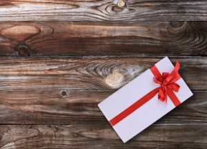Gift box over wooden background